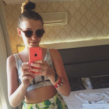 Top knot and ray bans